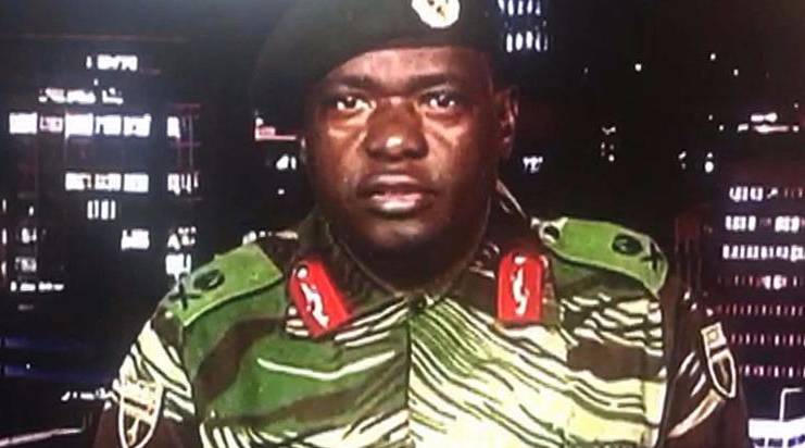 """Zimbabwe Major General Sibusiso Moyo reading a statement at the ZBC broadcast studio in Harare. Zimbabwe's military appeared to be in control of the country on November 15 as generals denied staging a coup but used state television to vow to target """"criminals"""" close to President Robert Mugabe"""